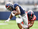 Mississippi running back Snoop Conner is tackled by Mohamed Sanogo (46) during the Grove Bowl spring NCAA college football game at Vaught-Hemingway Stadium in Oxford, Miss., Saturday, April 6, 2019. (Bruce Newman/The Oxford Eagle via AP)