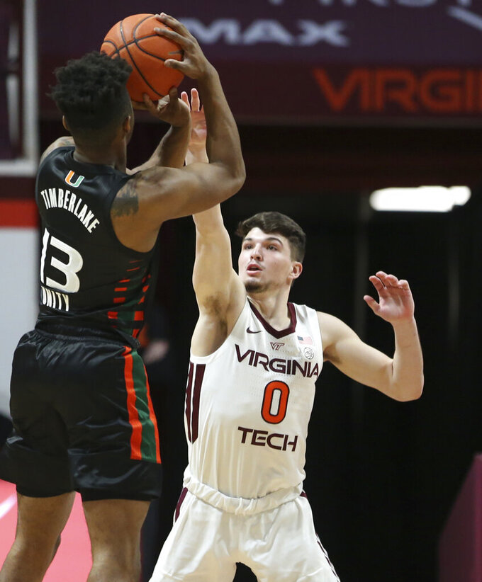 Miami's Earl Timberlake (13) shoots over Virginia Tech's Hunter Cattoor (0) during the first half of an NCAA college basketball game, Tuesday, Dec. 29, 2020 in Blacksburg, W.Va. (Matt Gentry/The Roanoke Times via AP, Pool)