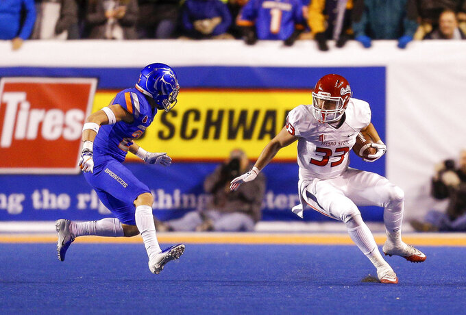 Fresno State running back Josh Hokit (33) carries against Boise State during the first half of an NCAA college football game Friday, Nov. 9, 2018, in Boise, Idaho. (AP Photo/Steve Conner)