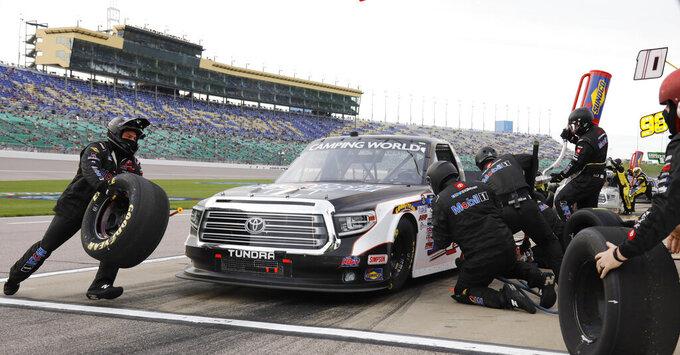 John Nemechek (4) makes a pit stop during a NASCAR Truck Series auto race at Kansas Speedway in Kansas City, Kan., Saturday, May 1, 2021. (AP Photo/Colin E. Braley)
