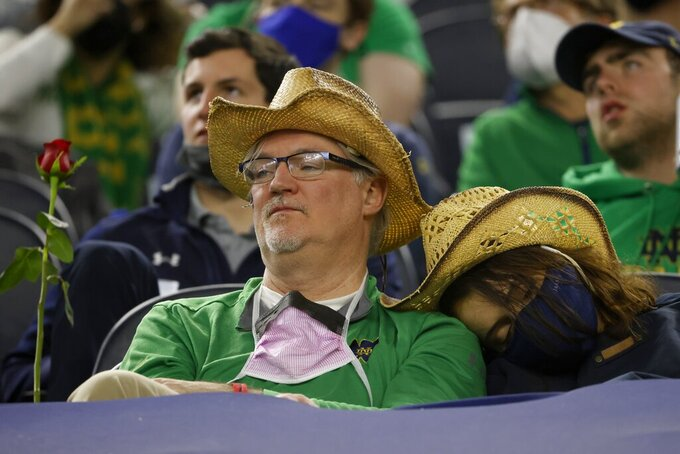 Notre Dame fans watch their team play Alabama late in the second half of the Rose Bowl NCAA college football game in Arlington, Texas, Friday, Jan. 1, 2021. (AP Photo/Ron Jenkins)