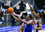 Louisiana Tech forward Isaiah Crawford (22) attempts a layup as Mississippi forward Robert Allen (21) defends during the second half of an NCAA college basketball game in the NIT, Friday, March 19, 2021, in Frisco, Texas. (AP Photo/Brandon Wade)