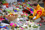 Mourners lay flowers near the Linwood mosque in Christchurch, New Zealand, Thursday, March 21, 2019.  Police officials in New Zealand say the man responsible for killing 50 people at two mosques was on his way to a third attack when police arrested him. (AP Photo/Vincent Thian)