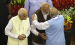 Indian Prime Minister Narendra Modi,second right, hugs senior Bharatiya Janata Party (BJP) leader M.M.Joshi as L.K.Advani, left, watches after being elected ruling alliance leader, in New Delhi, India, Saturday, May 25, 2019. BJP president Amit Shah announced Modi's name as the leader of the National Democratic Alliance in a meeting of the lawmakers in the Central Hall of Parliament in New Delhi, paving the way for Modi's second five-year term as prime minister after a thunderous victory in national elections. (AP Photo/Manish Swarup)