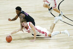 Wisconsin's Tyler Wahl (5) and Penn State's Izaiah Brockington (12) dive for a loose ball during the second half of an NCAA college basketball game at the Big Ten Conference tournament, Thursday, March 11, 2021, in Indianapolis. (AP Photo/Darron Cummings)