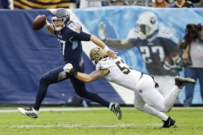 Tennessee Titans quarterback Ryan Tannehill (17) is sacked by New Orleans Saints outside linebacker A.J. Klein (53) in the first half of an NFL football game Sunday, Dec. 22, 2019, in Nashville, Tenn. (AP Photo/James Kenney)