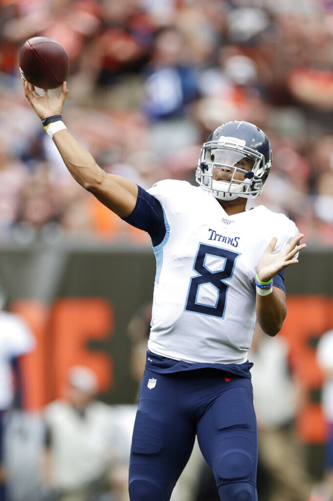 Tennessee Titans quarterback Marcus Mariota passes during the first half in an NFL football game against the Cleveland Browns, Sunday, Sept. 8, 2019, in Cleveland. (AP Photo/Ron Schwane)