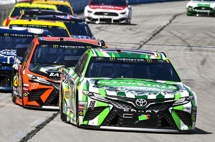 Driver Kyle Busch (18) heads into turn 1 during a NASCAR Cup auto race at Texas Motor Speedway, Sunday, March 31, 2019, in Fort Worth, Texas. (AP Photo/Larry Papke)