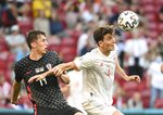 Spain's Pau Torres, right, and Croatia's Marcelo Brozovic challenge for the ball during the Euro 2020 soccer championship round of 16 match between Croatia and Spain at Parken stadium in Copenhagen, Denmark, Monday, June 28, 2021.(AP Photo/Jonathan Nackstrand, Pool)