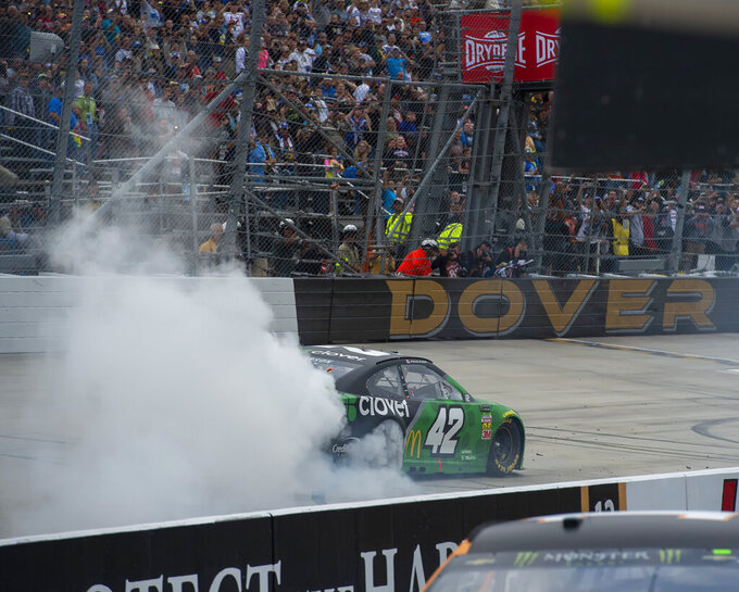Kyle Larson No. (42) does a burn out after winning the Drydene 400 - Monster Energy NASCAR Cup Series playoff auto race, Sunday, Oct. 6, 2019, at Dover International Speedway in Dover, Del. (AP Photo/Jason Minto)