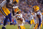 LSU wide receiver Ja'Marr Chase (1) celebrates his touchdown reception with wide receiver Josh Hammond (10) and wide receiver Justin Jefferson (2) in the second half of an NCAA college football game against Florida in Baton Rouge, La., Saturday, Oct. 12, 2019. LSU won 42-28. (AP Photo/Gerald Herbert)
