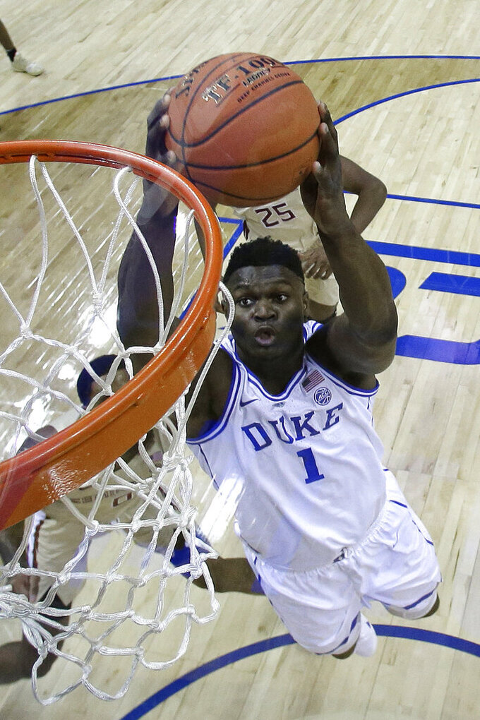 FILE - In this March 16, 2019, file photo, Duke's Zion Williamson (1) goes up to dunk against Florida State during the first half of the NCAA college basketball championship game of the Atlantic Coast Conference tournament in Charlotte, N.C. Duke returned to the top 10 in the Director's Cup standings behind its national champion women's golf team and a flagship men's basketball program that boasted arguably the nation's most recognizable college athlete _ Zion Williamson. Yet athletic director Kevin White called it a good _ but not great _ year overall.  (AP Photo/Chuck Burton, File)