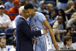 North Carolina head coach Roy Williams hugs North Carolina guard Christian Keeling (55) during the second half of an NCAA college basketball game against Virginia Tech at the Atlantic Coast Conference tournament in Greensboro, N.C., Tuesday, March 10, 2020. (AP Photo/Gerry Broome)