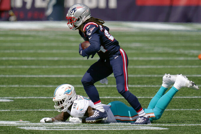 New England Patriots cornerback Stephon Gilmore runs after intercepting a pass against the Miami Dolphins in the first half of an NFL football game, Sunday, Sept. 13, 2020, in Foxborough, Mass. (AP Photo/Charles Krupa)