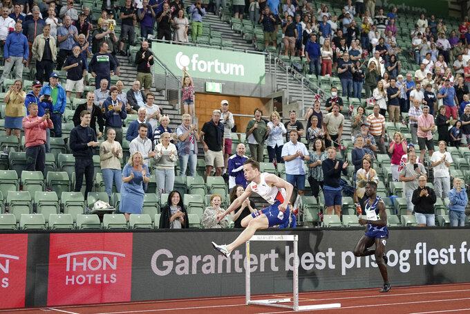 Norway's Karsten Warholm breaks 400 hurdles world record
