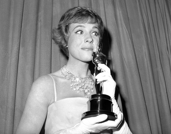 FILE - This April 6, 1965 file photo shows actress Julie Andrews holding her best actress Oscar for