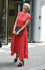 Heather Mills speaks to the media outside Rolls Building at the end of her phone-hacking legal claim against News Group Newspapers, in London, Monday July 8, 2019.  Businesswoman and campaigner, Heather Mills, settled her claim Monday over phone-hacking against News Group Newspapers (NGN), for a public apology and an undisclosed sum. (Kirsty O'Connor/PA via AP)