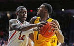 California guard Darius McNeill is defended by Arizona guard Justin Coleman (12) during the first half of pan NCAA college basketball game Thursday, Feb. 21, 2019, in Tucson, Ariz. (AP Photo/Rick Scuteri)