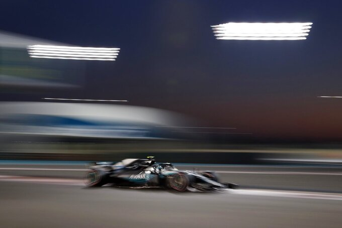 Mercedes driver Valtteri Bottas of Finland steers his car during the second free practice at the Yas Marina racetrack in Abu Dhabi, United Arab Emirates, Friday, Nov. 23, 2018. The Emirates Formula One Grand Prix will take place on Sunday. (AP Photo/Hassan Ammar)