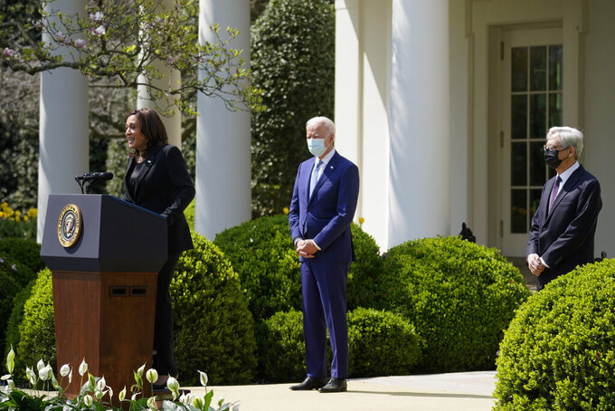 Vice President Kamala Harris accompanied by President Joe Biden and Attorney General Merrick Garland, speaks about gun violence prevention in the Rose Garden at the White House, Thursday, April 8, 2021, in Washington. (AP Photo/Andrew Harnik)