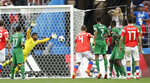 Russia's Alexander Golovin, right, scores his side's fifth goal during the group A match between Russia and Saudi Arabia which opens the 2018 soccer World Cup at the Luzhniki stadium in Moscow, Russia, Thursday, June 14, 2018. (AP Photo/Matthias Schrader)