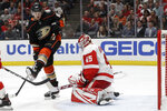 Detroit Red Wings goaltender Jonathan Bernier, right, blocks a shot by Anaheim Ducks right wing Rickard Rakell during the second period of an NHL hockey game in Anaheim, Calif., Tuesday, Nov. 12, 2019. (AP Photo/Chris Carlson)