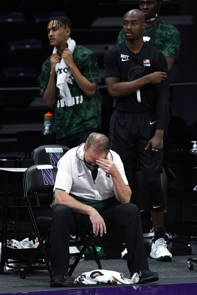Michigan State head coach Tom Izzo, bottom, reacts during the second half of an NCAA college basketball game against Northwestern in Evanston, Ill., Sunday, Dec. 20, 2020. Northwestern won 79-65. (AP Photo/Nam Y. Huh)