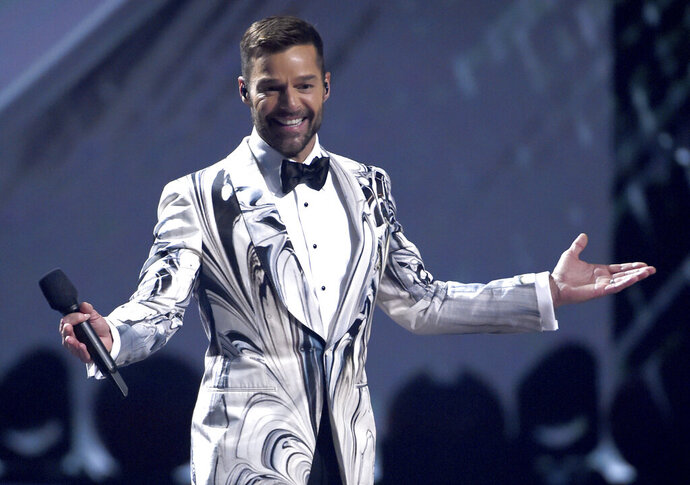 CORRECTS DATE OF EP RELEASE TO THURSDAY MAY 28 - FILE - This Nov. 14, 2019 file photo shows host Ricky Martin at the 20th Latin Grammy Awards in Las Vegas. Martin released an EP Thursday, May 28, called