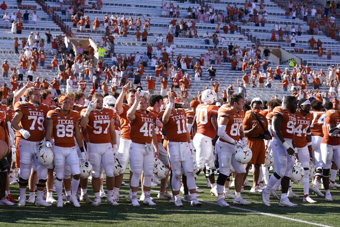"Texas players sing ""The Eyes of Texas"" after an NCAA college football game against West Virginia in Austin, Texas, Saturday, Nov. 7, 2020. (AP Photo/Chuck Burton)"