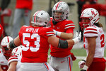 Ohio State quarterback Jack Miller, center, celebrates his touchdown against Nebraska with teammate Luke Wypler during the second half of an NCAA college football game Saturday, Oct. 24, 2020, in Columbus, Ohio.  (AP Photo/Jay LaPrete)