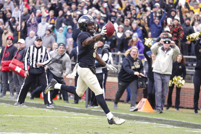 Purdue wide receiver David Bell (3) runs in for a game-winning touchdown against Nebraska in the final minute of an NCAA college football game in West Lafayette, Ind., Saturday, Nov. 2, 2019. Purdue defeated Nebraska 31-27. (AP Photo/Michael Conroy)