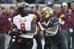 Maryland defensive back Marcus Lewis (8) holds onto the ball after making an interception against Minnesota wide receiver Rashod Bateman (13) during an NCAA college football game Saturday, Oct. 26, 2019, in Minneapolis. (AP Photo/Stacy Bengs)