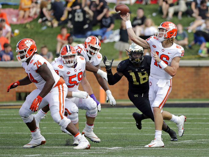 Clemson's Trevor Lawrence (16) throws a pass against Wake Forest during the first half of an NCAA college football game in Charlotte, N.C., Saturday, Oct. 6, 2018. (AP Photo/Chuck Burton)