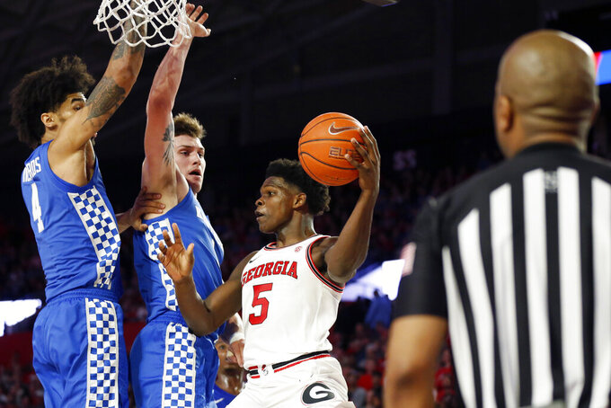 Kentucky forwards Nick Richards (4) and Nate Sestina (1) is defend against Georgia's Anthony Edwards (5) during an NCAA college basketball game Tuesday, Jan. 7, 2020, in Athens, Ga. (Joshua L. Jones/Athens Banner-Herald via AP)