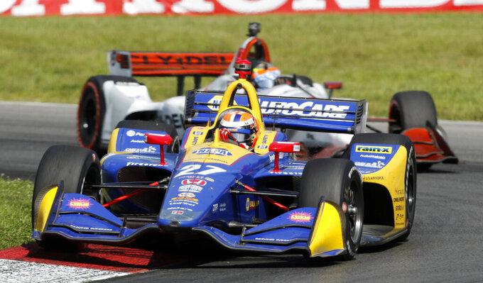 Alexander Rossi leads Santino Ferrucci through a corner during an IndyCar Series auto race, Sunday, July 28, 2019, at Mid-Ohio Sports Car Course in Lexington, Ohio. (AP Photo/Tom E. Puskar)