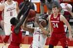 Wisconsin's Jonathan Davis tries to shoot past Nebraska's Lat Mayen during the second half of an NCAA college basketball game Tuesday, Dec. 22, 2020, in Madison, Wis. (AP Photo/Morry Gash)