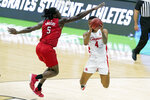 Houston's Justin Gorham (4) drives against Rutgers' Cliff Omoruyi (5) during the first half of a college basketball game in the second round of the NCAA tournament at Lucas Oil Stadium in Indianapolis Sunday, March 21, 2021. (AP Photo/Mark Humphrey)
