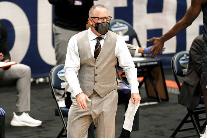 Texas A&M head coach Buzz Williams watches the action in the second half of an NCAA college basketball game against Vanderbilt in the Southeastern Conference Tournament Wednesday, March 10, 2021, in Nashville, Tenn. (AP Photo/Mark Humphrey)