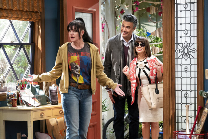 This image released by CBS shows, from left, Pauley Perrette, Jaime Camil and Natasha Leggero in a scene from the sitcom