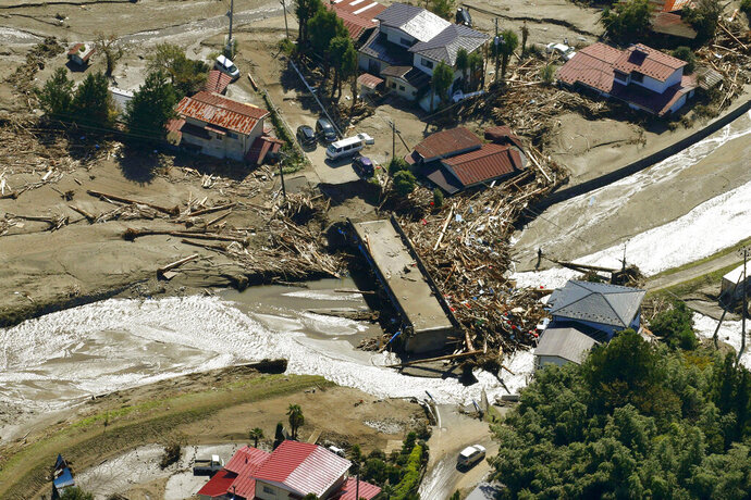 Driftwood is piled around a bridge after Typhoon Hagibis hits the town in Marumori, Miyagi prefecture, northern Japan Wednesday, Oct. 16, 2019. The typhoon hit Japan's main island on Saturday with strong winds and historic rainfall that caused more than 200 rivers to overflow, leaving thousands of homes flooded, damaged or without power. (Kyodo News via AP)