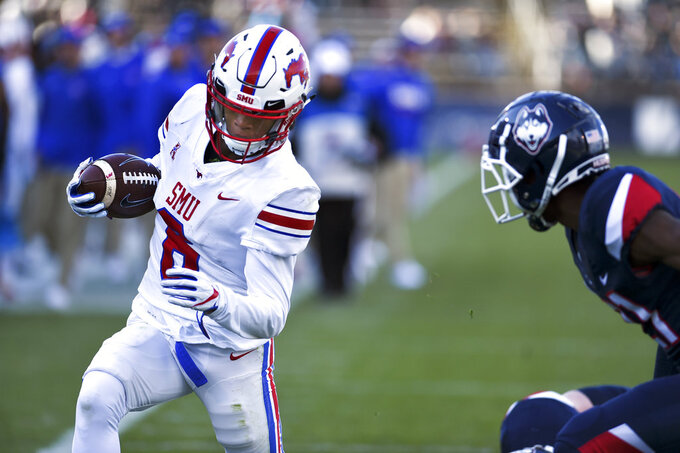 SMU running back Braeden West (6) scores the team's fourth touchdown in the first half of an NCAA college football game against Connecticut, Saturday, Nov. 10, 2018, in East Hartford, Conn.(AP Photo/Stephen Dunn)