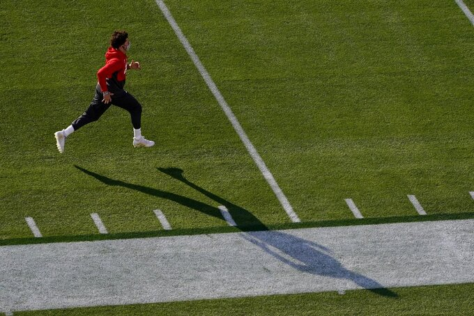 Kansas City Chiefs quarterback Patrick Mahomes runs as he warms up before the NFL Super Bowl 55 football game between the Kansas City Chiefs and Tampa Bay Buccaneers, Sunday, Feb. 7, 2021, in Tampa, Fla. (AP Photo/Charlie Riedel)