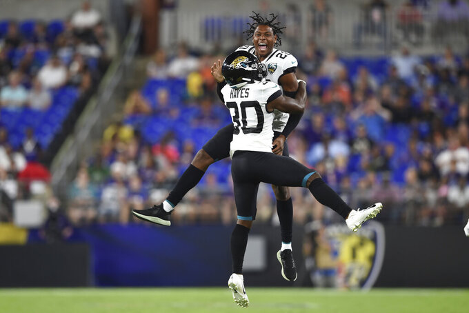 Jacksonville Jaguars defensive back Tae Hayes (30) and cornerback Jalen Ramsey (20) celebrate after an interception of a pass by Baltimore Ravens quarterback Trace McSorley during the first half of an NFL football preseason game Thursday, Aug. 8, 2019, in Baltimore. (AP Photo/Gail Burton)