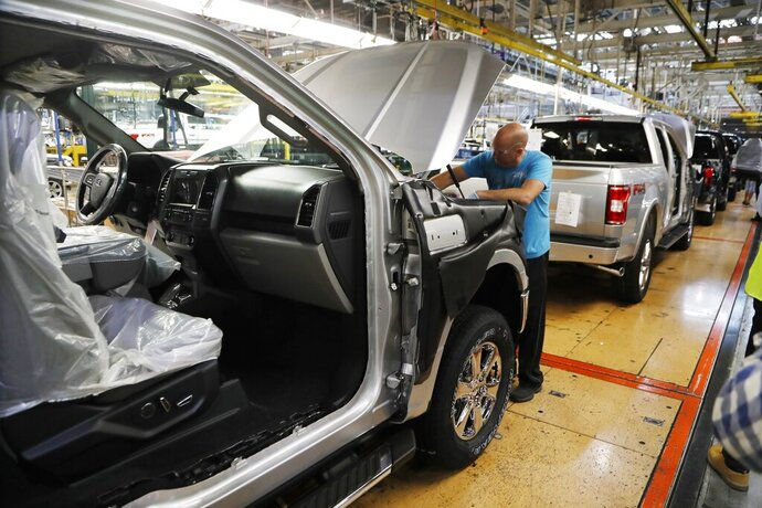 FILE- In this Sept. 27, 2018, file photo a United Auto Workers assemblyman works on a 2018 Ford F-150 truck being assembled at the Ford Rouge assembly plant in Dearborn, Mich. On Friday, Jan. 18, 2019, the Federal Reserve reports on U.S. industrial production for December. (AP Photo/Carlos Osorio, File)