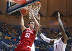 Boston University forward Max Mahoney (51) passes the ball as he is defended by West Virginia forward Derek Culver (1) during the first half of an NCAA college basketball game Friday, Nov. 22, 2019, in Morgantown, W.Va. (AP Photo/Kathleen Batten)