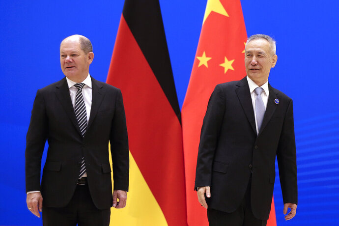 German Finance Minister Olaf Scholz, left, and Chinese Vice Premier Liu He arrive for the China-Germany High Level Financial Dialogue at the Diaoyutai State Guesthouse in Beijing, Friday, Jan. 18, 2019. (AP Photo/Andy Wong, Pool)