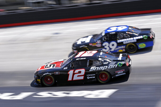 Driver Joey Logano (12) races through a turn with Ryan Sieg (39) during practice for an NASCAR Xfinity Series auto race on Thursday, Aug. 15, 2019, in Bristol, Tenn. (AP Photo/Wade Payne)