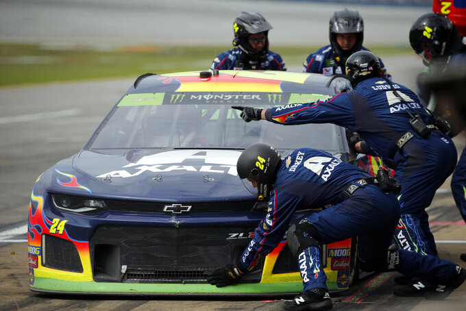William Byron (24) stops for refueling during a NASCAR Cup Series auto race at Talladega Superspeedway, Monday, Oct 14, 2019, in Talladega, Ala. (AP Photo/Butch Dill)