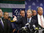 Patrolman's Benevolent Association President Patrick Lynch, center, gestures as he speaks during a news conference at PBA headquarters Monday, Aug. 19, 2019, in New York, following a decision to terminate NYPD Officer Daniel Pantaleo, who was involved in the chokehold death of Eric Garner in 2014. Pantaleo's attorney Stuart London is at right. The police department flag hangs upside down behind Lynch. The decision was welcomed by activists and Garner's family, but immediately condemned by the head of the city's largest police union, who declared that it would undermine morale and cause officers to hesitate to use force under any circumstances, for fear they could be fired. (AP Photo/Kathy Willens)