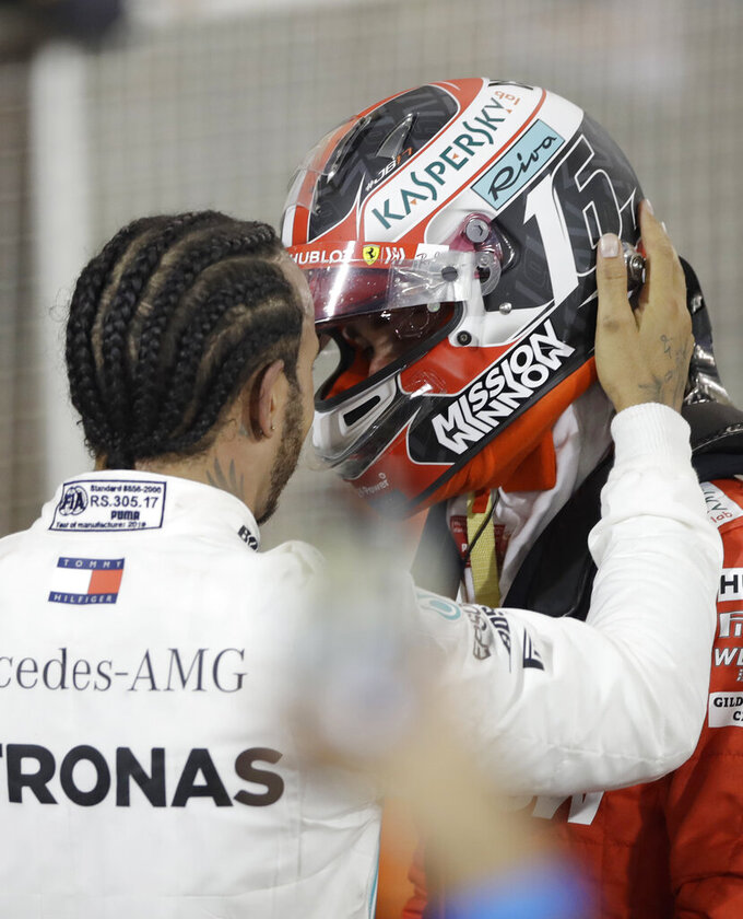 First place winner, Mercedes driver Lewis Hamilton of Britain, left, congratulates with Ferrari driver Charles Leclerc of Monaco, third place, after the Bahrain Formula One Grand Prix at the Bahrain International Circuit in Sakhir, Bahrain, Sunday, March 31, 2019. (AP Photo/Luca Bruno)
